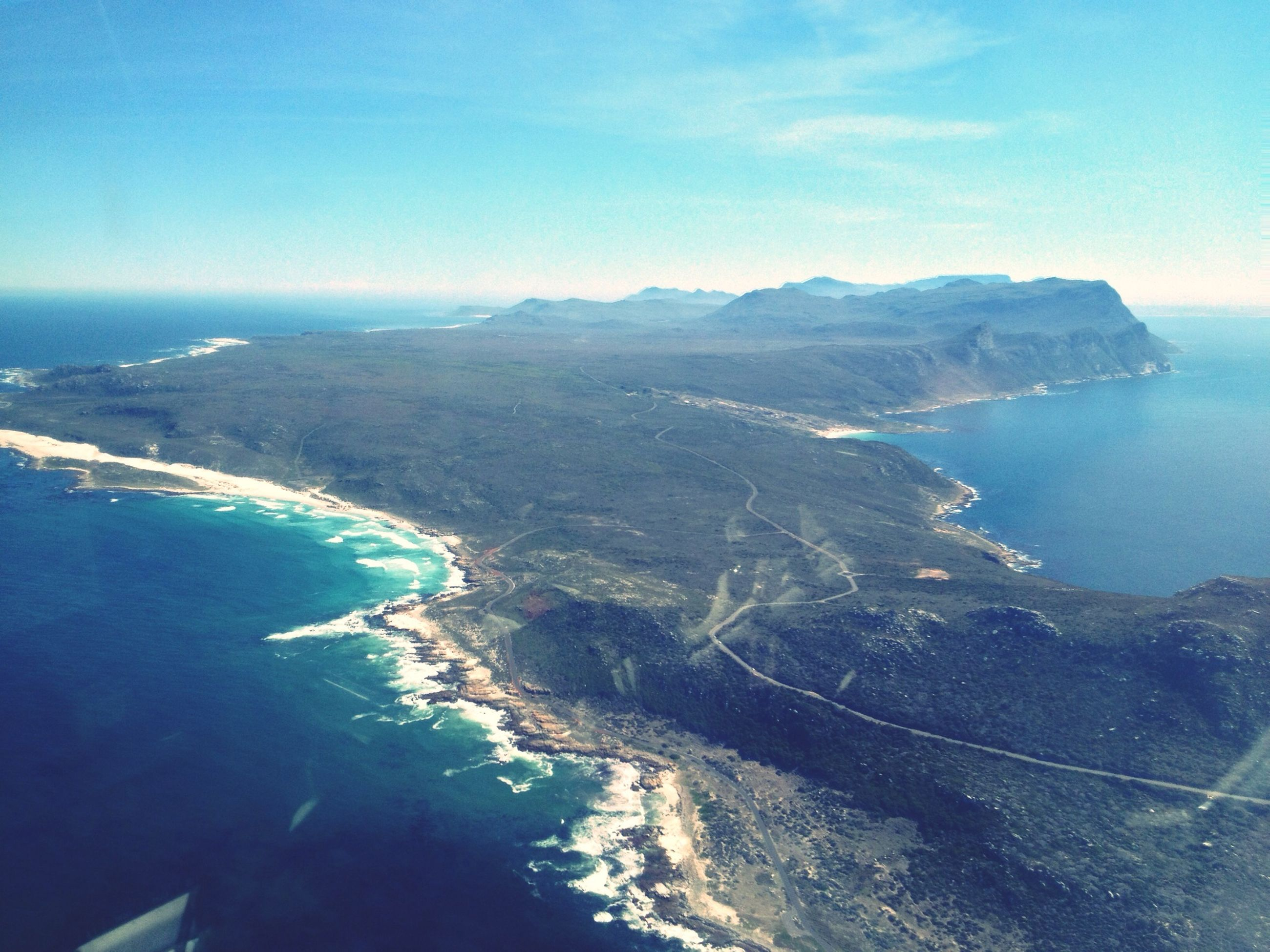 sea, mountain, scenics, water, aerial view, tranquil scene, beauty in nature, blue, tranquility, high angle view, mountain range, nature, coastline, sky, landscape, idyllic, day, outdoors, no people, horizon over water