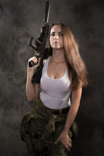 Adult Aggression  Beautiful Woman Clothing Gun Hair Hairstyle Handgun Holding Long Hair Looking At Camera One Person Portrait Standing Three Quarter Length Weapon Women Young Adult Young Women