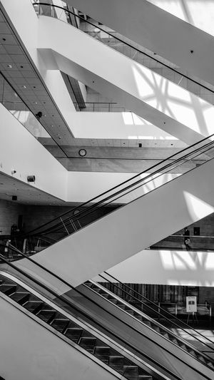 Better in black and white? Interior Escalator Escalators No People Modern City Abstract Architecture Built Structure Steps And Staircases Stairway Hand Rail Staircase Steps Stairs