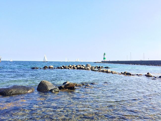 Schleswig-Holstein Schleimünde Schlei Sea Water Clear Sky Sailboat Tranquility Tranquil Scene Copy Space Rock - Object Scenics Travel Destinations Waterfront Non-urban Scene Seascape Nature Beauty In Nature Calm Blue Day Distant Ocean