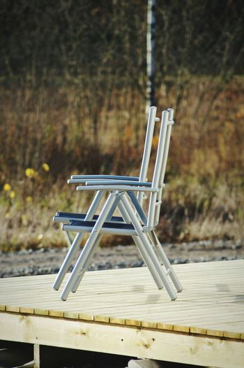 Empty chairs on wooden floor