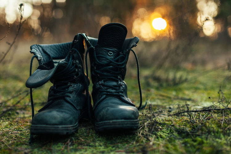 brutal bearded man in the autumn forest Black Color Body Part Boot Close-up Clothing Focus On Foreground Grass Hiking Human Body Part Human Foot Lace - Fastener Leather Nature Outdoors People Plant Protection Safety Security Selective Focus Shoe Shoelace Tree