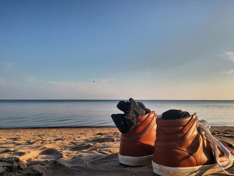 Sea Horizon Over Water Beach Water Sand Sky Shore Calm Day Blue Coastline Outdoors Nature Ocean Shoes Brown Shoes Chill Sunset