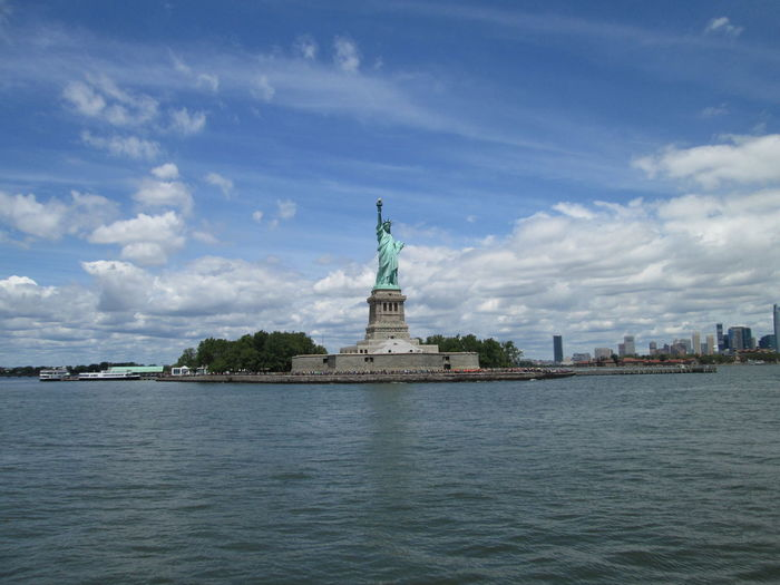 Statue Of Liberty By Sea Against Sky