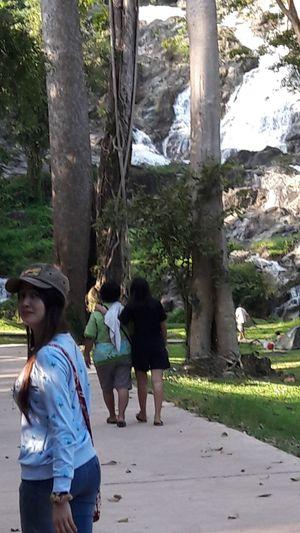 Young Women Togetherness Women Friendship Full Length Men Bonding Tree Walking Candid