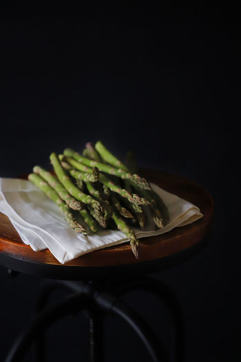 Close-up of food on table against black background