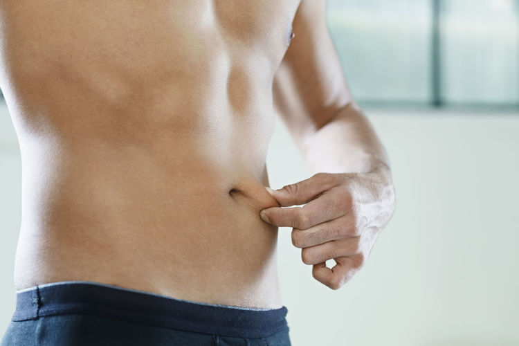 Midsection of shirtless man