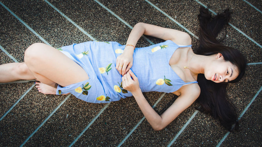 Lying Down High Angle View Real People Leisure Activity Lifestyles Full Length Relaxation People Women Young Adult Day Lying On Back Casual Clothing Two People Young Women Child Smiling Childhood Outdoors Hairstyle Innocence Portrait