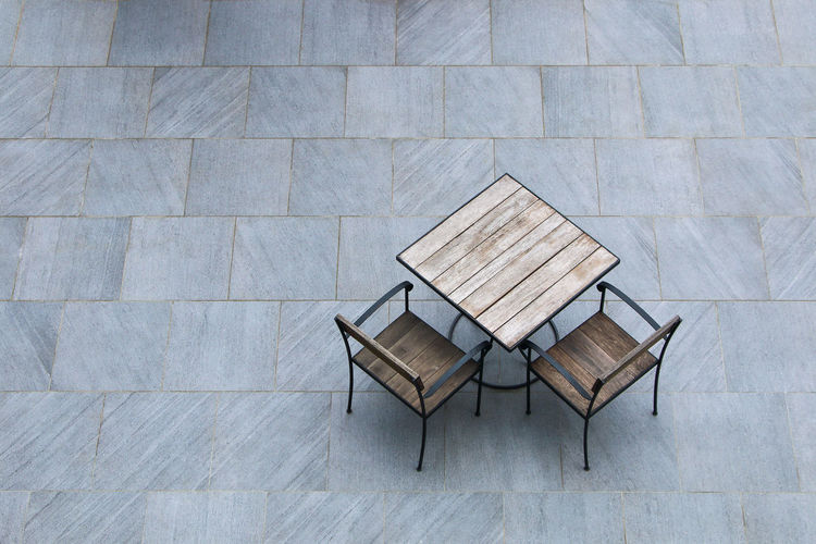 High angle view of chairs and table on floor