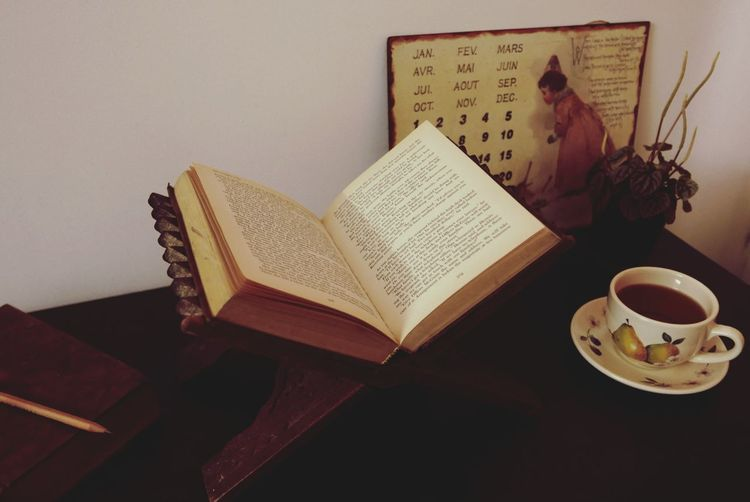 I looked everywhere for peace and quiet and the only place I found it was with my book in a little nook.- Thomas van Kempen Books Tea Plant My Desk Love Books Old Books Leica D-lux Typ109 Peace And Quiet