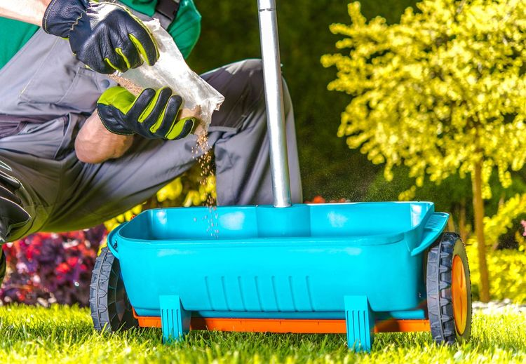 Midsection of man gardening at backyard
