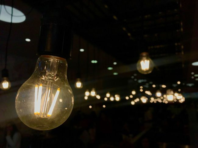 Light bulbs Illuminated Lighting Equipment Light Bulb Electricity  Focus On Foreground Night Glowing Glass - Material Filament No People Light Close-up Bulb Electric Light Indoors  Transparent Hanging Light - Natural Phenomenon Fuel And Power Generation Technology