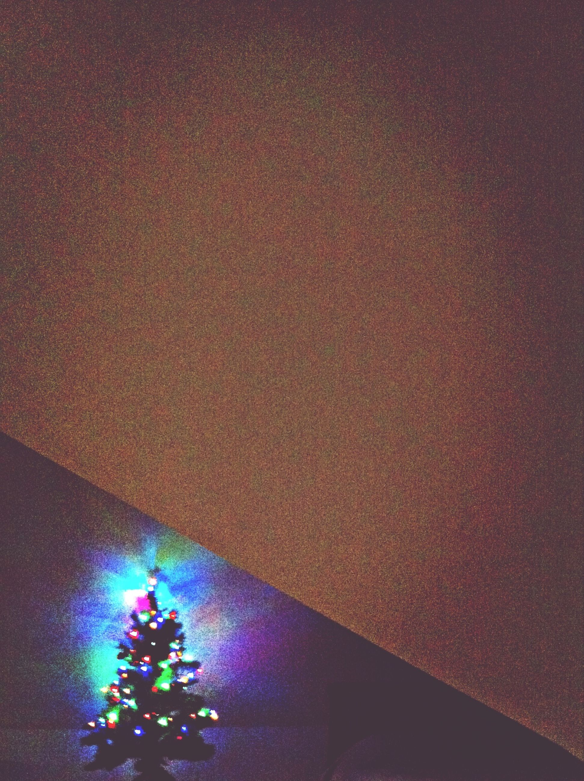 illuminated, indoors, lighting equipment, decoration, celebration, multi colored, light - natural phenomenon, night, low angle view, glowing, wall - building feature, no people, hanging, purple, high angle view, christmas decoration, christmas, pink color, decor, home interior