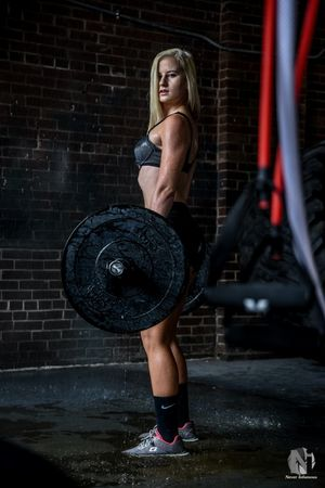 Hardbody Halle. Lifestyles Leisure Activity Casual Clothing Person Side View Full Length Young Women Young Adult Brick Wall Long Hair Contemplation Woman Portrait Model Photoshoot Portrait Of A Woman Gym Water Fitnessmodel Fitness Fashion Weights Workout People In Places Pennsylvania