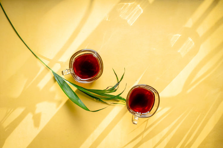 High angle view of red wine glass on table
