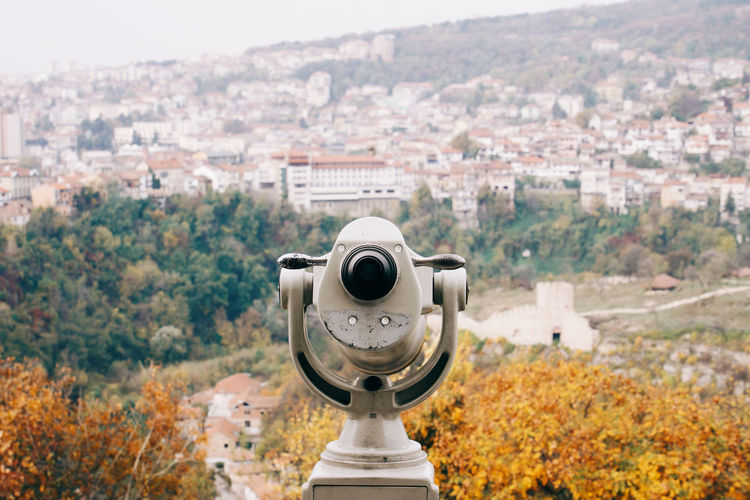 High Angle View Of Binoculars Against Cityscape