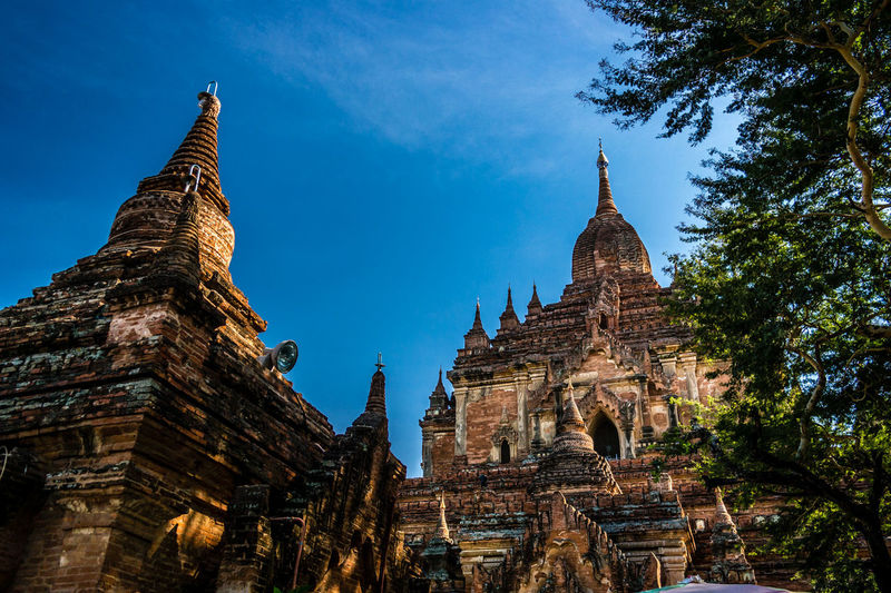 Low angle view of old buddhist temples against sky