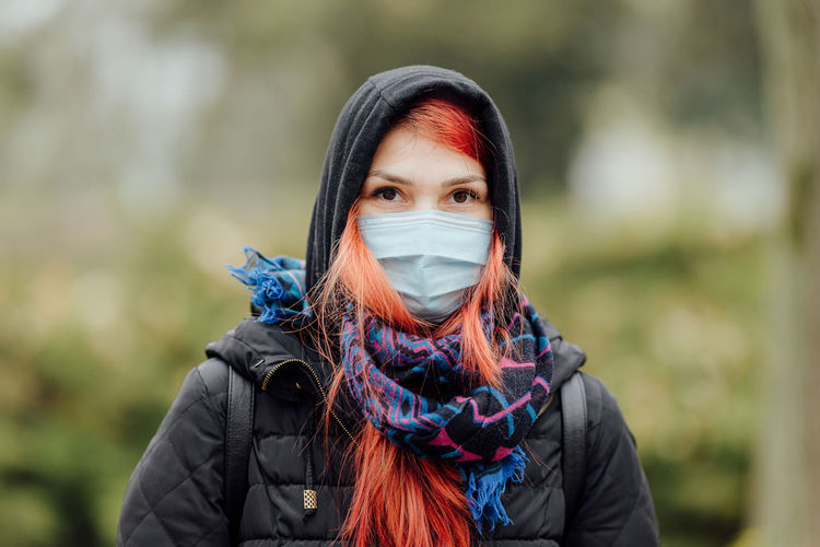 Single mom wearing a face mask outdoor in covid-19 pandemic times