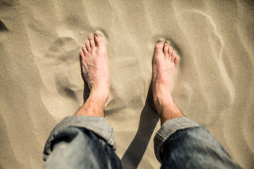 Adult Adults Only Bare Feet Bare Feet In The Sand Barefoot Beach Close-up Day High Angle View Human Body Part Human Foot Jeans Shopping Low Section One Man Only One Person Only Men Outdoors People Sand Summer Times  Take The Step Vacations Wanr Water Where My Feet Are