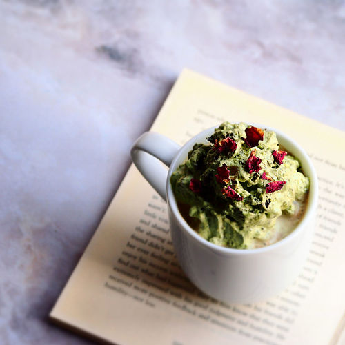 Matcha cream cafe latte rose petal on top Matcha Relaxing Book Close-up Coffee Break Coffee Cup Food And Drink Green Tea Healthy Eating High Angle View Refreshment Simplicity Still Life Table Tea Time