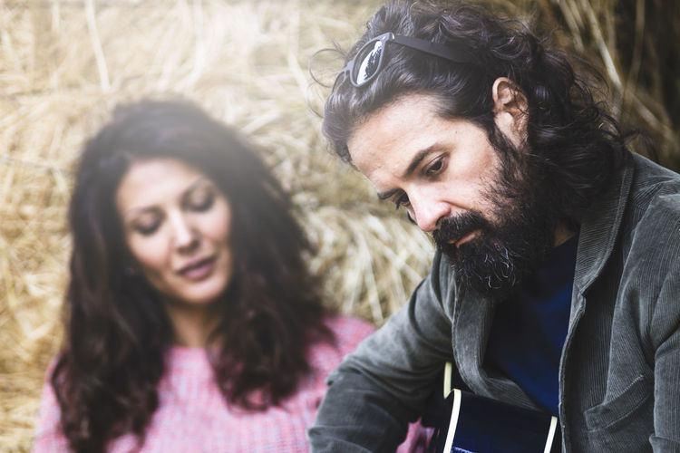 Beard Blur Close-up Couple Day Defocused Defocused Background Farm Farm Life Guitar Guitarist Lifestyles Men Outdoors People Real People Relationship Relationship Difficulties Togetherness Two People Woman Young Adult Young Women