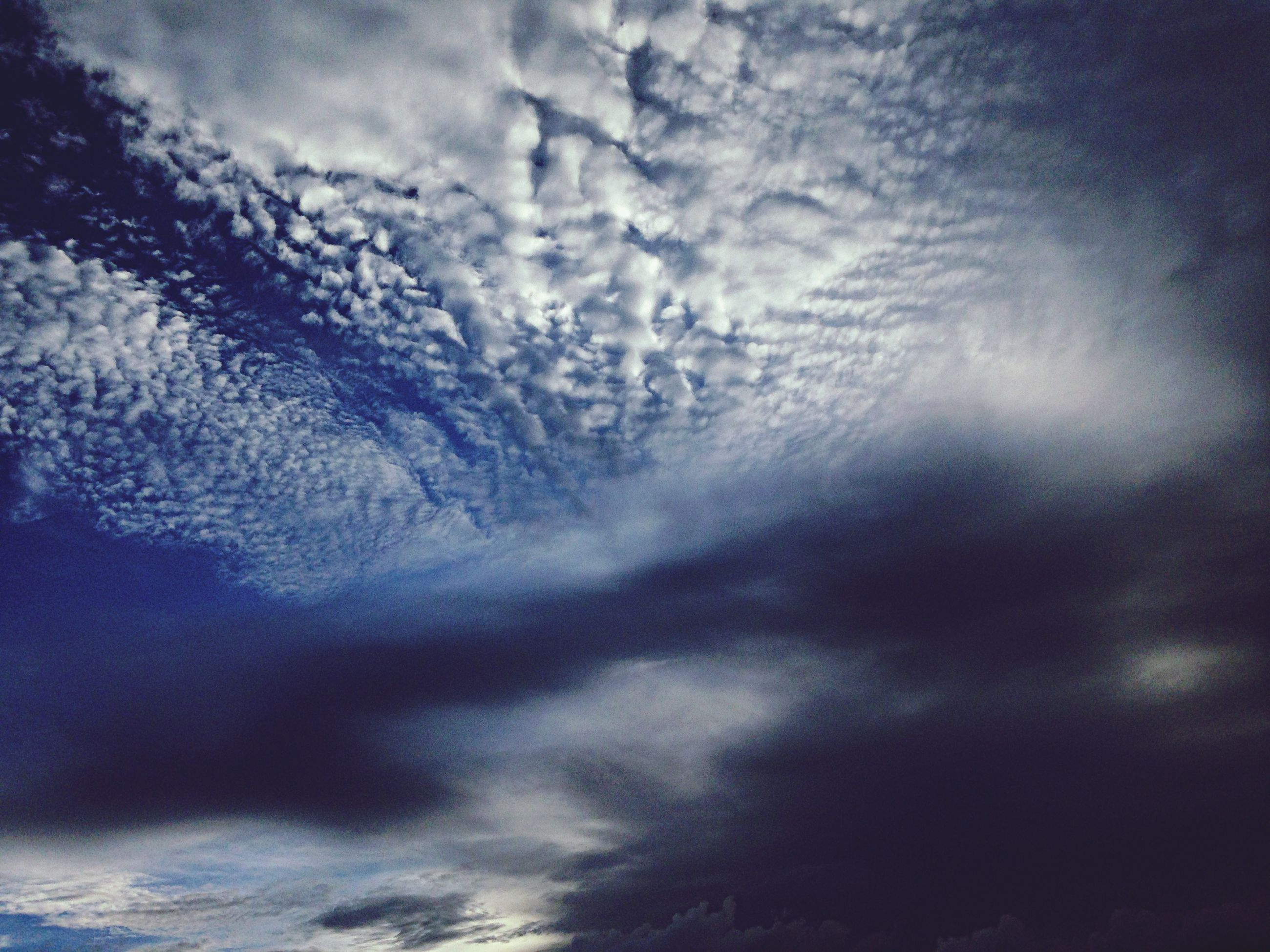 sky, cloud - sky, low angle view, cloudy, tranquility, beauty in nature, weather, nature, scenics, tranquil scene, idyllic, dusk, overcast, cloud, outdoors, cloudscape, backgrounds, tree, storm cloud, silhouette