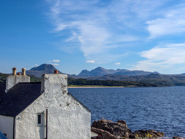 Gairloch Architecture Beauty In Nature Blue Building Exterior Built Structure Cloud - Sky Day Mountain Mountain Range Nature No People Outdoors Scenics Sky Tranquility Travel Destinations Water