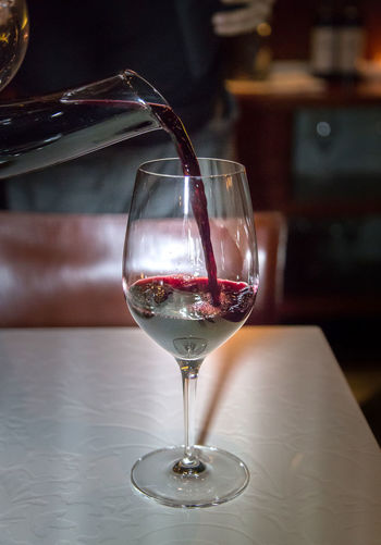 Red Wine being poured from Decanter Red Wine Wine Glass Wine Not Wine moments Wine Tasting Alcohol Alcoholic Drink Close-up Day Decanter Decanter And Glassware Drink Drinking Glass Focus On Foreground Food And Drink Freshness Indoors  No People Red Wine Refreshment Table Wine Wineglass