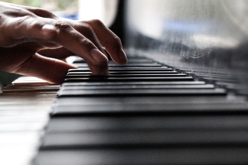 Close-Up Of Man Playing Piano