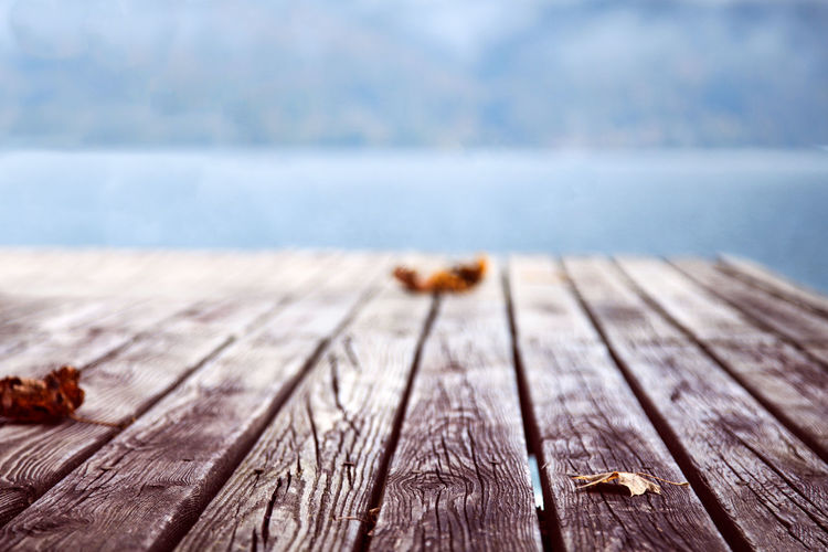 Surface level of wooden plank against sea