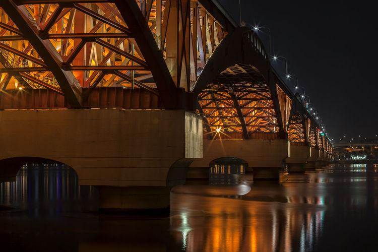 Illuminated seongsan bridge over han river against sky at night