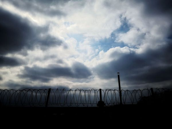 Security Cloud - Sky Protection Sky Outdoors Crime Silhouette Prison Day No People Nature Confined Space