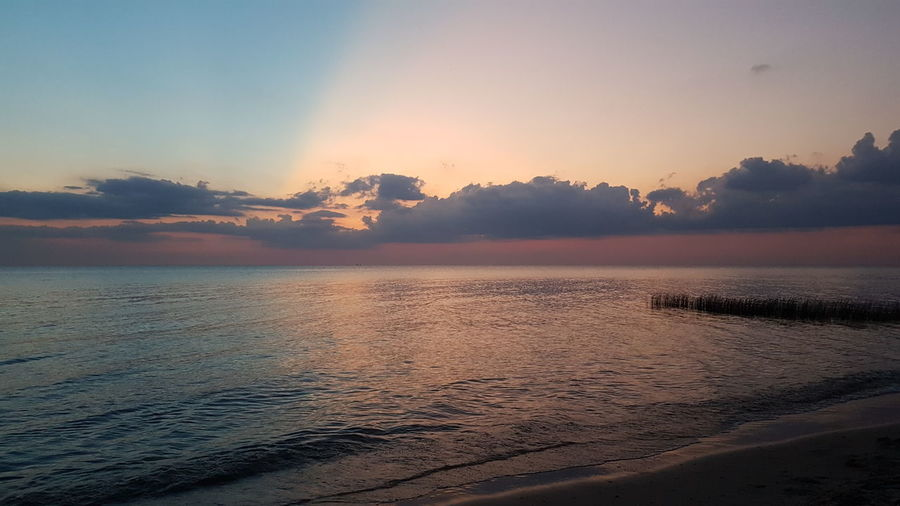 Water Sunset Nature Sky Landscape Sun Lake Blue Tranquility Outdoors Scenics No People Sand Beauty In Nature Day Beach