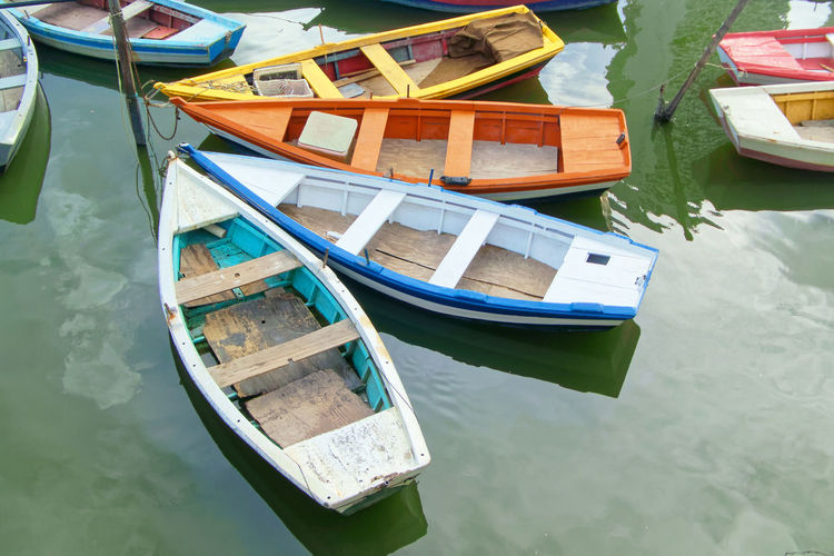 High angle view of fishing boats moored in lake