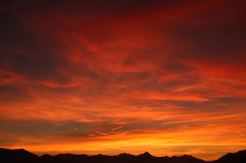 Mountain Sunset Backgrounds Silhouette Dramatic Sky Red Orange Color Sky Landscape Idyllic Moody Sky Non-urban Scene Scenics Mountain Range Atmospheric Mood Romantic Sky Calm