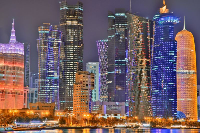 City scape doha Boat Nightlife Corniche Wooden Cruise Buldings Doha Qatar Building Exterior Built Structure Architecture Building Skyscraper Night Office Building Exterior City Cityscape Illuminated Tall - High Modern Urban Skyline Landscape Residential District Tower Travel Destinations Downtown District Travel Financial District  The Architect - 2018 EyeEm Awards