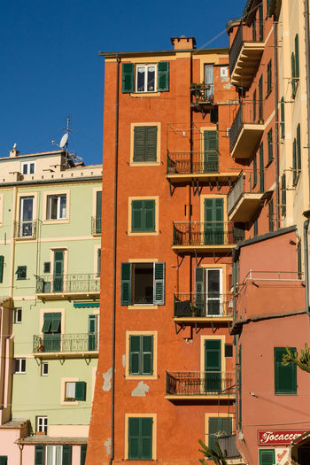 Building Exterior Architecture Built Structure Building Residential District Window City No People Day Low Angle View Sunlight Sky Outdoors Clear Sky Town House Orange Color City Life