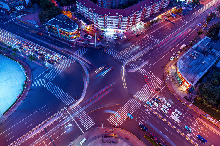 At the intersection of the evening City Economy Horizontal Composition Intersection Prosperity Road Roads Spectacular Tianjin Traffic Transport Development In The Evening Landscape Neon Lights Night Overlooking Traffic Flow Traffic Lights Zebra Crossing EyeEmNewHere