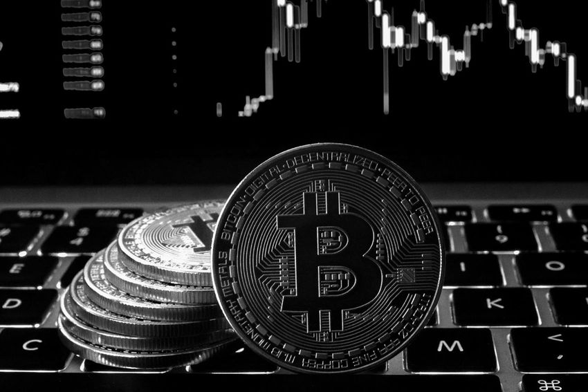 Bitcoin digital cryptocurrency coin minted resting on computer keyboard in black and white with market screen. Altcoins Broker Candlesticks Stocks And Bonds Trends Analysis Backlit Banking Bitcoin Block Chain Close-up Computer Cryptocurrency Data Finance Future Indoors  Initial Coin Offering Keyboard Money No People Payment System Peer To Peer Stock Market Technology