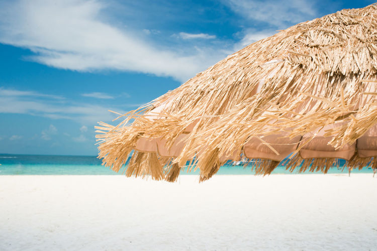 Thatched beach umbrella, closeup Caribbean Sea Beach Beach Umbrella Beauty In Nature Day Horizon Over Water Idyllic Nature No People Outdoors Relax Sand Scenics Sea Sky Summer Thatched Roof Thatched Umbrella Tranquil Scene Tranquility Tropical Vacations Water