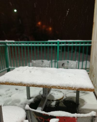 Close-up of snow on chair