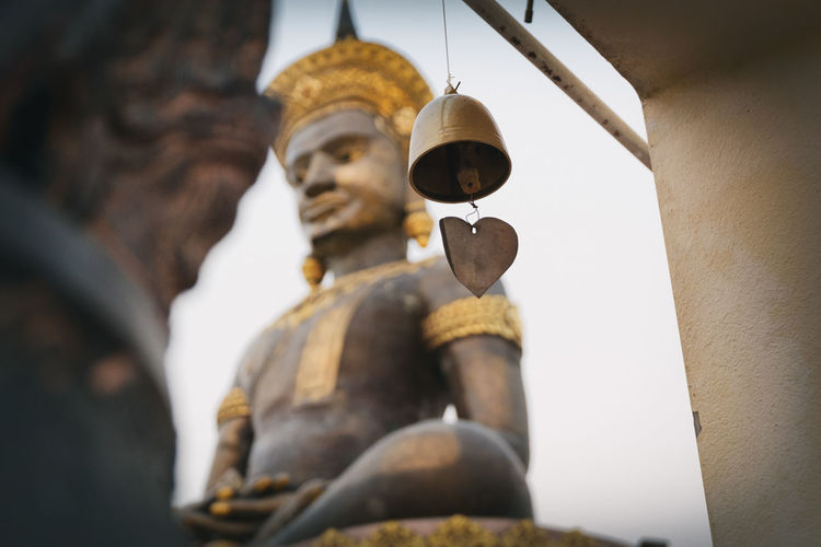 Low angle view of buddha statue