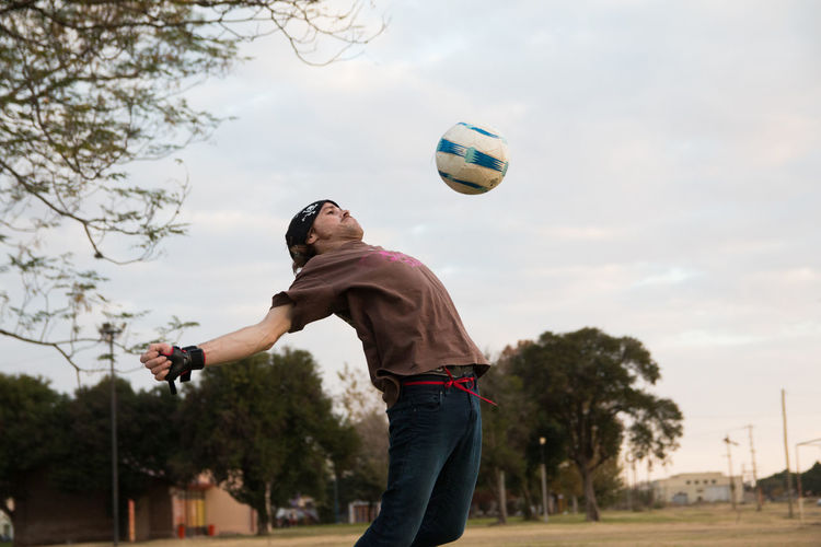 Man jumping to catch soccer ball