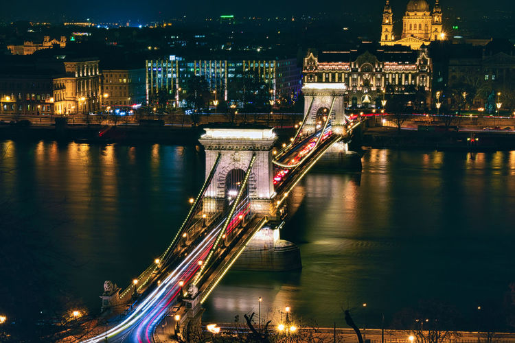 Aerial view of bridge over river at night