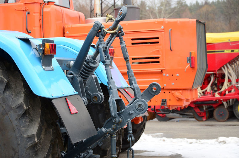 Construction vehicles in parking lot during winter