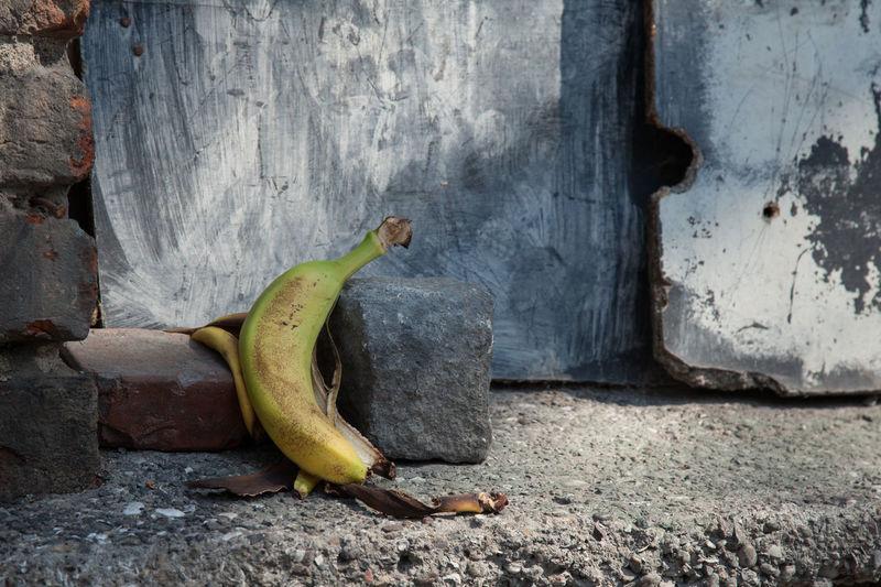discarded banana peel Concrete Banana Banana Peel Day Garbage Istanbul No People Skin Thrown Tossed Trash Turkey Yellow