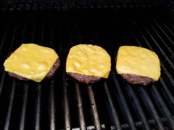 Three cheese burgers on the grill Burgers Cheeseburgers CheeseBurger Grilling Grilled Grilled Meat Food And Drink Food Foodphotography Dinner Food Photography Foodie Summer Meat! Meat! Meat! Grill Barbecue Hamburger Cheesebuger Three From Above  Grilling Out BBQ Yummy Overhead View Color Photography