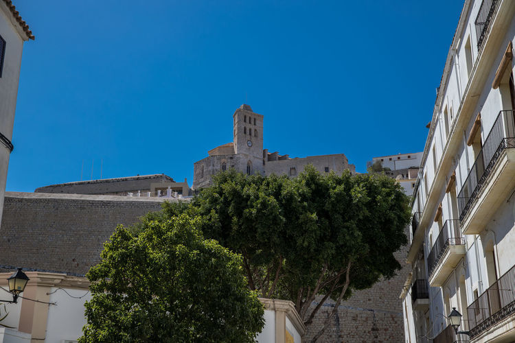 EyeEmNewHere Architecture Belief Blue Building Building Exterior Built Structure City Clear Sky Dalt Vila Day History Ibiza Stadt Low Angle View Nature No People Outdoors Plant Religion Sky Sunlight The Past Tree Old Ruin Church Historic Building Castle Historic