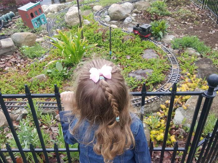 High angle view of girl looking at model at park