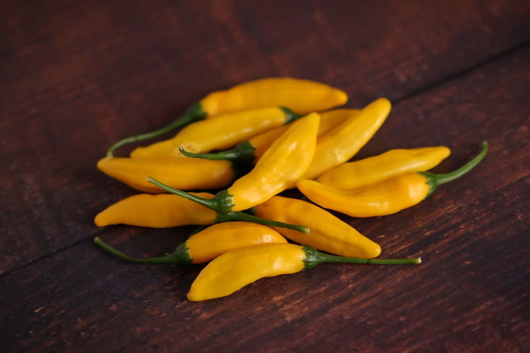 Close-up of yellow chili peppers on table